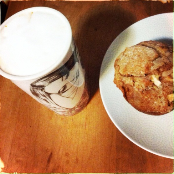 Frothy coffee and an apple and caramel muffin