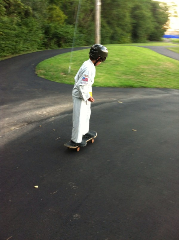 Skateboarding to karate. September 2013.